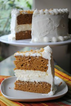 This pumpkin cheesecake cake has two layers of pumpkin cake with a creamy layer of cheesecake and a generous coating of cream cheese frosting.