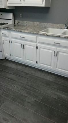 Best Laminate Flooring for Kitchen Awesome Nice Dark Grey Laminate Planking and White Cabinets Grey Kitchen Floor, New Kitchen, Kitchen Decor, Kitchen Design, Stylish Kitchen, Kitchen Ideas, Gray Floor, Kitchen With Dark Floors, Basement Kitchen