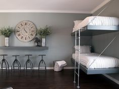 **CLOCK **The room comes with plenty of bunk beds to accommodate kids and guests. Adjustable metal stools beneath the wall-mounted bar provide additional seating. Bunk Bed Rooms, Kids Bunk Beds, Bedrooms, Blue Grey Walls, Diy Room Decor For Teens, Room Paint, Fixer Upper, Plank, Family Room