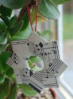Origami Wreath | Paper Craft Tutorial | Content in a Cottage ,,, Christmas ornament made of upcycles sheet music ... delightful!!