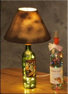 We, Nick mostly :), have made several of our lighted bottles into Bottle Lamps with Lamp Shades now. This involves adding a lamp kit and coordinating lamp shade. The lamp kit is pretty easy to find...