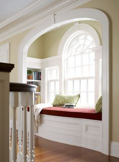 Love the window seat, spider web window. Beautiful molding details.