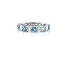 An 18ct White Gold, Sky Blue Topaz and Diamond Eternity Ring