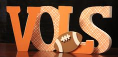 Tennessee Vols sign Freestanding Wooden letters with football  - Volunteers Game room sign plaid. $25.00, via Etsy.