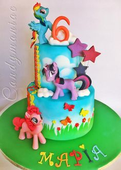 Inside this colorful pony cake there is chocolate mud cake and orange flavored Swiss meringue buttercream. All the figures are hand made with no use of molds.