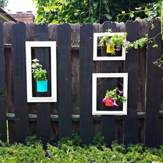 Use thrift store picture frames and up cycled soup cans as planters to add color to your outdoor space.