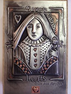 The queen of hearts done in pewter with touches of copper patina placed on a bridge card box. Mary Ann Lingenfelder, Mimmic Gallery and Studio.
