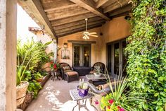 Mediterranean Porch with Wrap around porch, exterior tile floors, Raised beds