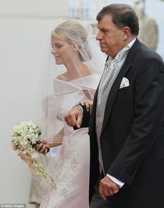 Princess Charlene's hair and veil are oh so elegant, here her father walks her down the aisle as she gets ready to marry her Prince!