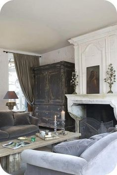 Gorgeous Living Room....love the fireplace & antique Armoire, etc.