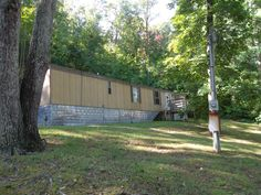 PRICE REDUCED! Less than 2 miles from Big Ridge State Park & public boat launch on Norris lake. Ideal investment or retirement property with income potential. 2 mobile homes on 2 acres with 4 homes permitted. Third site is prepped & ready with utilities. 1st home is 1993 14x48 2br/1bth with electric heat. 2nd home is 12x56 1978 2br 1bth w/appliances. Both had new cpt/vinyl 2yrs ago.Each home 672 sqft. Move in ready. Nice mtn views w/ convenience & privacy. $39,995