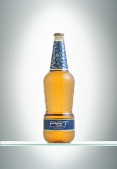 GLASS BEER.0.75l. Creating a beer bottle in PET able to show the versatility of PET in terms of applications, decorations and production dynamics. The material used, Glasstar from Novapet, gave to the bottle the typical transparency of glass, making it become unbreakable and lighter.