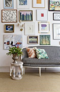 wall collage & striped couch