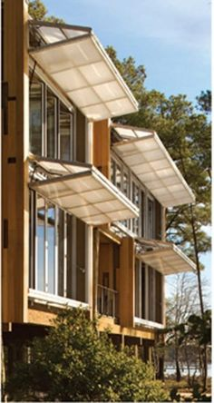 Façade consists of translucent polycarbonate hangar doors that fold horizontally. Loblolly House, Kieran Timberlake Associates You are in the right place about media facade Here we offer you the most Detail Architecture, Interior Architecture, Chinese Architecture, Futuristic Architecture, Exterior Design, Interior And Exterior, Passive House, Windows And Doors, House Windows