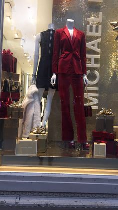 - Image 14 - 11/17/16 @ 6:30pm - Michael Kors 5th Avenue NYC - iPhone 6 Plus - I chose this image because it is great for the holidays. The gold is so eye-catching and it caught my attention when I was walking down 5th Avenue. The red suit goes perfectly with the color scheme of the display. I also love how the mannequin in the black dress is holding a fur coat. I have never seen a display mannequin holding something like that before.