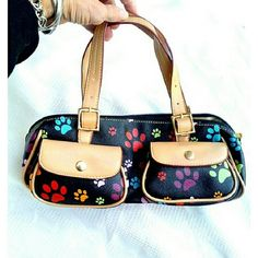 """CUTE ANIMAL PAW PRINT POCKETBOOK   CUTE ANIMAL PAW PRINT POCKETBOOK     * L 12"""" X W 5"""" D 5""""    * 1 Inside Zipper & 2 Attached Compartments    * 2 Outside Snap POCKETS    * PU Material Very cute ! Open to FAIR offers. Bags Satchels"""