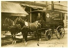 Team of horses pulling a Vernor's Ginger Ale delivery wagon.  The driver is seated in the front of the wagon which is parked at the curb in front of a grocery store and a dry cleaning and dyeing shop.  The photo may have been taken on Scotten Ave between Porter St and Ida Ave.     c.1909  (Detroit Hist. Soc.)