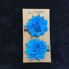 This set of hair clips is perfect to dress up any outfit! This set includes two clips as pictured above. Each mini shabby flower measures