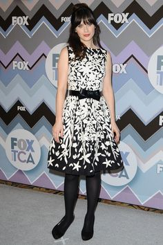 """For 2013 this fabulous, sleeveless, graphic print, black white. flared skirted dress looks so whimsical fun with comfy stylish pumps adorable """"bow"""" belt. Zoey Deschanel, Zooey Deschanel Style, Kate Bosworth, Jackie Kennedy, Anna Dello Russo, Heidi Klum, Celebrity Photos, Celebrity Style, Dakota And Elle Fanning"""
