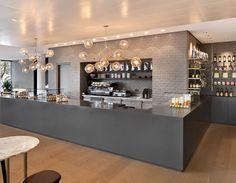 Two custom 9-globe chandeliers installed at Mercedes headquarters, Germany Designed byBollinger & Fehlig, interior by C+C InteriorsPhoto byKen Schluchtmann