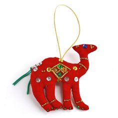 Handmade Beaded Camel Ornament - Hand Crafting Justice || Fair trade products bought from women overcoming social and economic injustice. Every purchase directly impacts the women and their families, worldwide. High quality, adorable, Christmas ornament for socially conscious holiday decor. Find more great products at @philorgs.