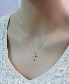Gold Cross Necklace is made with an 18K Gold Vermeil cross charm that dangles from a 14K Gold Filled chain. Very simple and elegant minimalist necklace that can be worn alone or layered with another necklace. 18K Gold Vermeil Cross Charm 19x10mm 14K Gold Filled Jump Ring 14K Gold Filled Chain  Free polishing cloth with every order