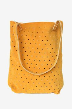 I would pair this Mustard Suede Dot Tote with some favorite light wash boyfriend jeans and an easy navy blue tee.