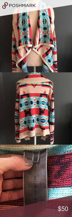 Navajo Asymmetrical Sweater Cardigan Emily Maynard Navajo tribal patterned asymmetrical waterfall sweater in coral cream black and turquoise. 100% acrylic. Cute and cozy styling as seen on The Bachelorette Emily Maynard.  Throw over jeans and a t-shirt and insta cute outfit! Last pic shows right lapel fabric from dry cleaner spot removal of red wine stain. Noticeable only if pointed out & inspected. Worn only twice. Priced accordingly. Smoke free seller.  No trades please.  Measurements…