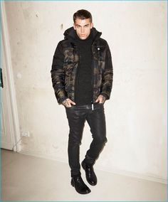 Stephen James rocks a camouflage G-Star Raw jacket with coated jeans for Theo…