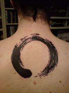 a buddhist tattoo. I'm not buddhist, but I like the idea of it looking like it's paint brushed.