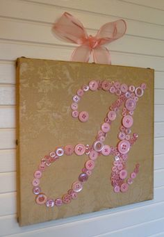 """Baby Girl Vintage Style Nursery Button Letter Art on 12""""x12"""" Canvas -- Pink Buttons on Gold Silk. $90.00, via Etsy."""