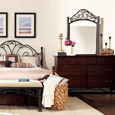 Store clothing and belongings in this beautiful seven-drawer cherry wood dresser and mirror set. Each drawer features ornate metal pull handles. The metal-framed mirror features decorative swirl designs. Display mementos on the dresser top.