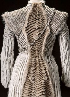 """daenerys-stormborn: """"Costume details of Daenerys' winter coat (x) - As for Dany's coat, Clapton wanted to keep the look in the same shape as the Mother of Dragon's other outfits this season. """"It was..."""