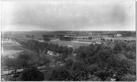 1900 to 1907 -- Aerial of Garden City Golf Club taken from tower at St.Paul's school.  Rockaway Avenue in foreground and 1st, 2nd, 17th holes at golf club. Zoom in along horizon you  can see original Nassau County Courthouse building, back of the Mineola Fair grandstand to right, and to left is the original Nassau Hospital building complex and Nurse's Home..