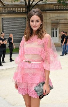 Olivia in pink lace for the Valentino show during Paris Fashion Week.