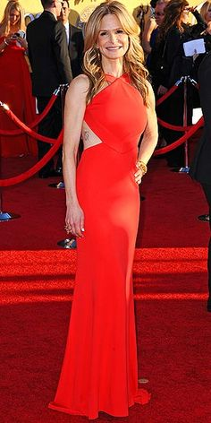 Work it Kyra Sedgwick.  Not many women can pull that dress off and look as hot as she does.  The tattoo showing is not quite my taste, but to each is own.  Love it!  A-