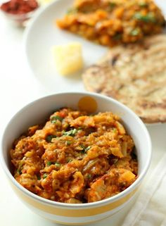 Baingan Bharta - A delicious smoky roasted eggplant cooked in onion tomato gravy with Indian spices.