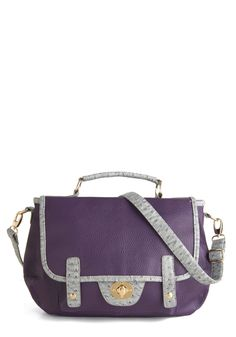 """Catch a Cab Bag - love the purple color --""""Featuring texturized vegan faux leather of a rich purple hue trimmed with smokey grey faux ostrich and a striped interior"""" - about 60 dollars"""