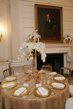 Dining & Diplomacy - Tables are set in the State Dining Room before the Social Dinner for His Royal Highness Prince Charles, The Prince of Wales, and the Duchess of Cornwall. courtesy of The George W. Bush Presidential Library and Museum