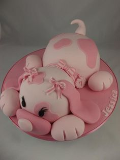 Pink puppy dog cake, I made this cake from Debbie Browns book. The dog in the book is blue but I was making this for a girl: