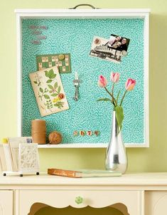Repurposing an old dresser drawer into a bulletin board.
