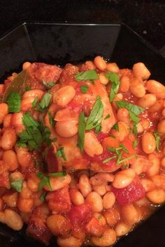 "Easy and Delicious Slow Cooker Cassoulet | ""Everyone in my family loved this. I used turkey bacon and kielbasa."" #slowcooker #slowcookerrecipes #crockpotrecipes #crockpotdinnerideas Slow Cooker Recipes, Crockpot Recipes, Easy, Dump Meals, Great Northern Beans, Bean Stew, Turkey Bacon, Ethnic Recipes"