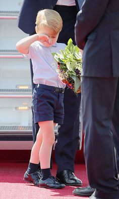 Prince George appeared tired after his plane journey.