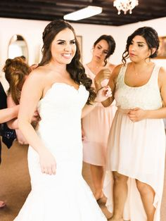 Take advantage of thick hair by pairing long curls with thick crown braids for a gorgeous wedding day hairstyle.