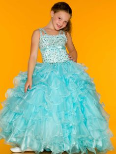 Size 6 Ice Blue In Stock!She'll be a winner in everyone's eyes because she really looks like a princess in this pageant little girls design. Let your girl have fun in this Sugar Mac Duggal 81675S gown that features double shoulder straps that adjoin a fully sequin bodice with natural waist and delicate ribbon sash around the empire waistline. A heavily ruffled skirt evokes a refreshing mint scent. Available in Ice Blue or Ice Pink. Tiaras, bows, flowers and hair bands are affordable at…