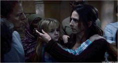 Marin Hinkle as Kathy with her daughter Briana in the horror movie Quarantine