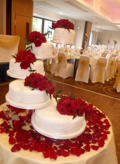 """White wedding cake with red roses un-stacked. We can help achieve this look at Dallas Foam with cake dummies, cupcake stands and cakeboards. Just use """"2015pinterest"""" as the item code and receive 10% off your first order @ www.dallas-foam.com. Like us on Facebook for more discount offers!"""