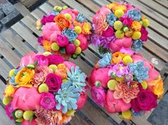 Bright coral and cerise colour clash wedding flowers with succulents