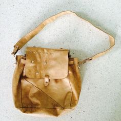 A personal favorite from my Etsy shop https://www.etsy.com/listing/203793877/vintage-saddle-tan-artists-leather-tote