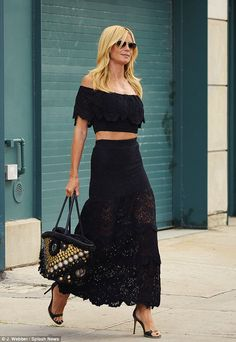 Top of the crops! Heidi Klum showed off her toned tum in a lace flamenco inspired skirt an...